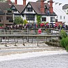 The crowds wait by Marlow lock to watch it continue it's journey down the River Thames